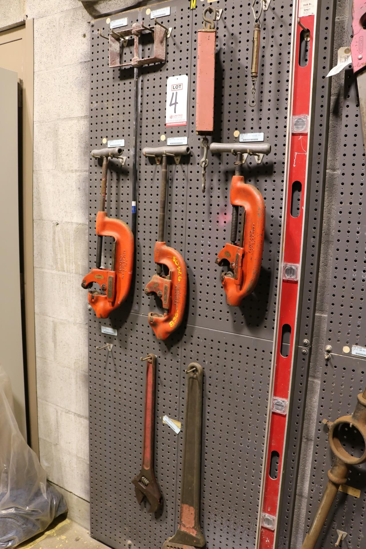 """Lot 4 - LOT - (1) SECTION OF STEEL PEG BOARD, 32"""" X 84"""", W/ CONTENTS: (2) RIDGID NO. 4-S AND (1) NO. 3-S"""