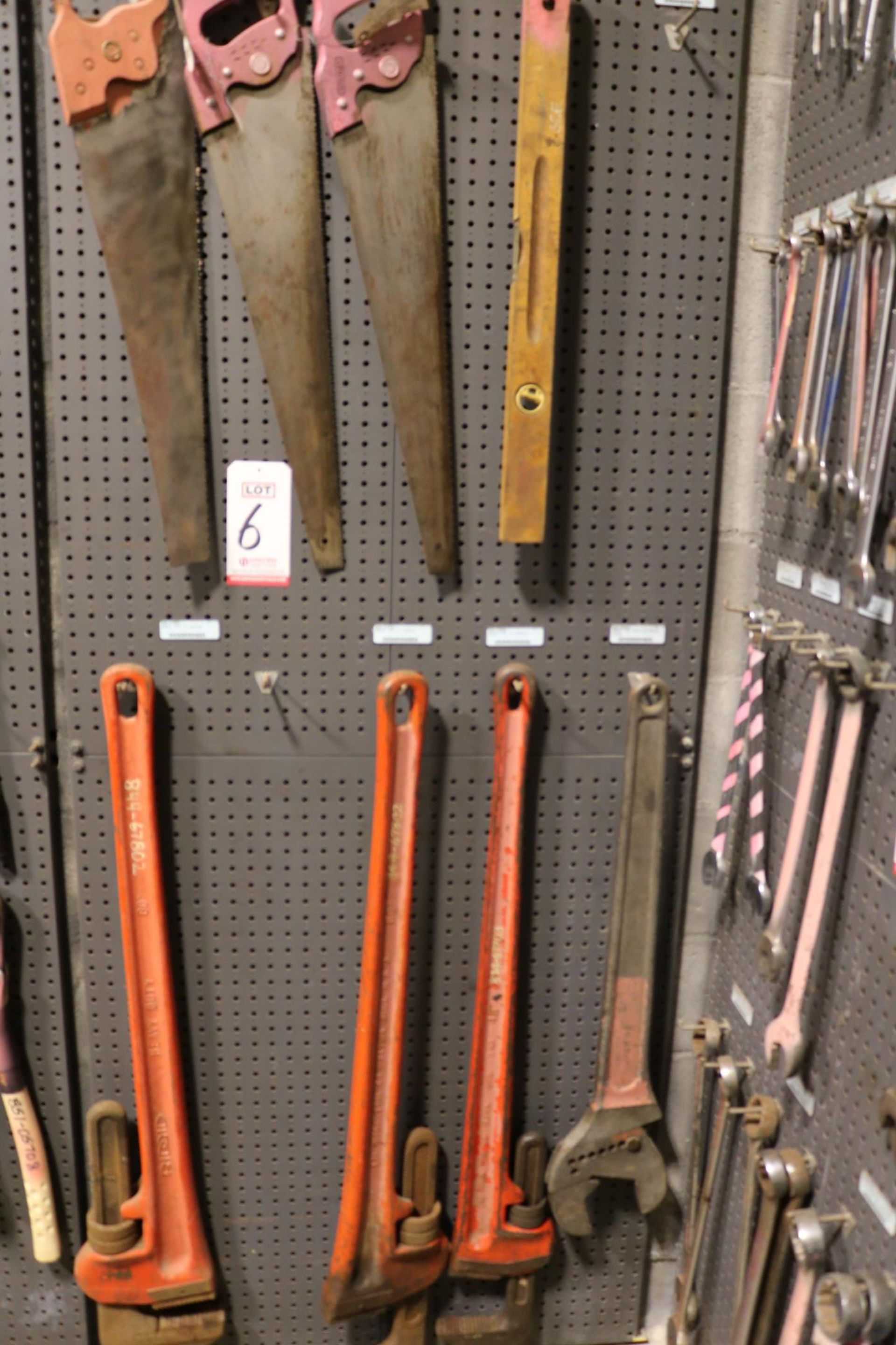 "Lot 6 - LOT - (1) SECTION OF STEEL PEG BOARD, 32"" X 84"", W/ CONTENTS: (3) LARGE RIDGID PIPE WRENCHES,"