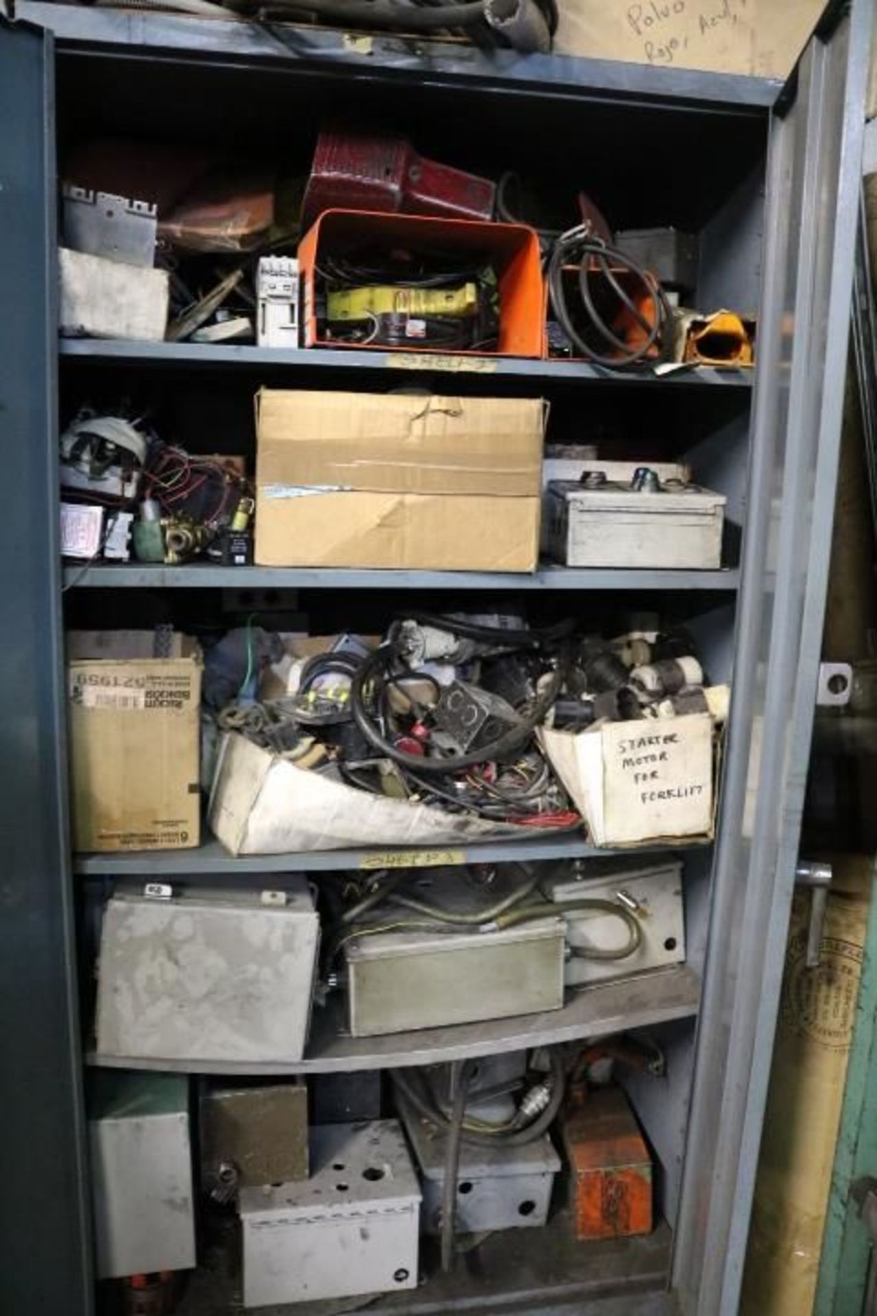 Lot 33 - CABINET W/ CONTENTS TO INCLUDE: HOSES, ELECTRICAL ADAPTERS, ETC.