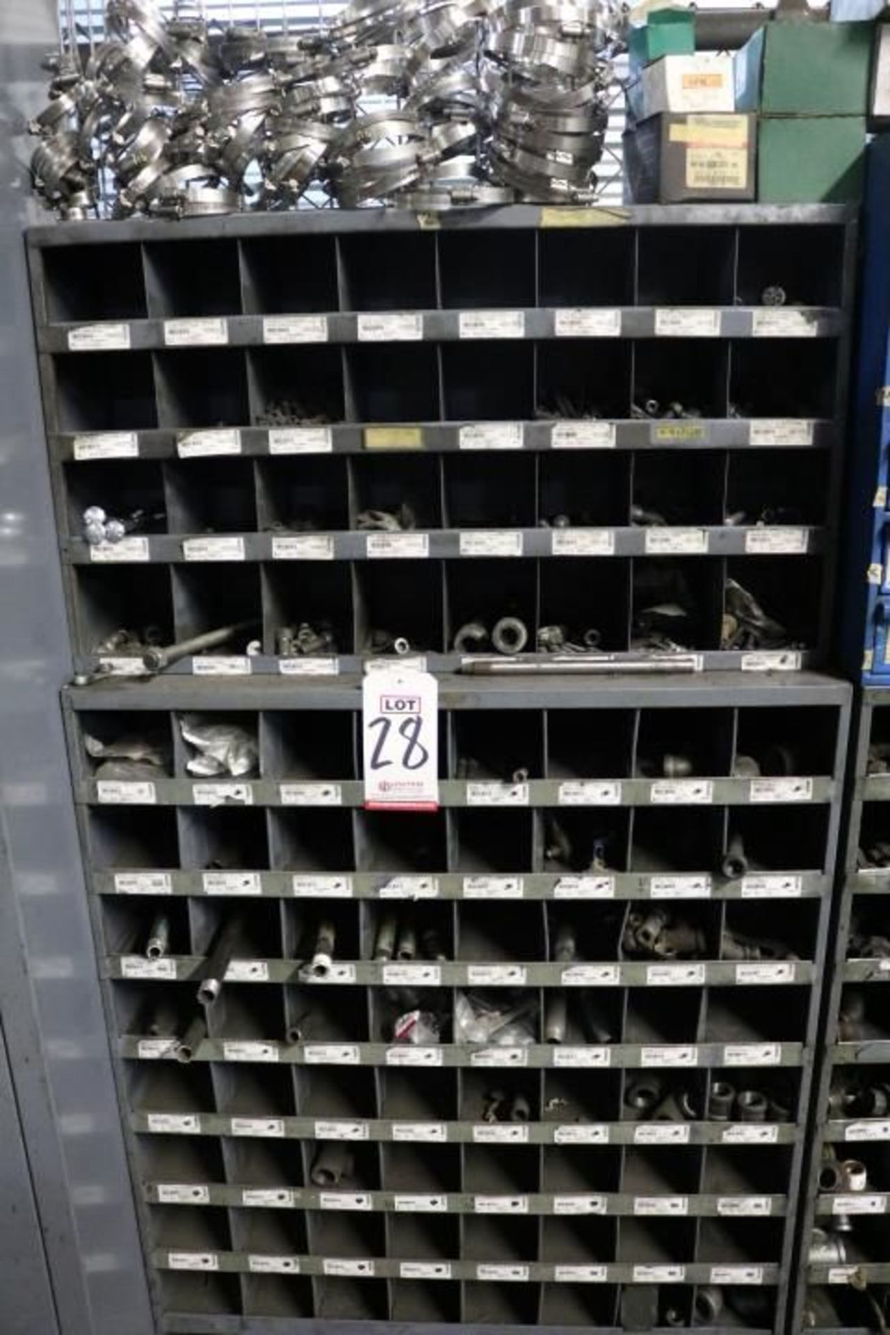 Lot 28 - HARDWARE CABINET W/ HOSE CLAMPS, STEEL ALLOY SCREWS, GALVANIZED STEEL ELBOWS, ETC.