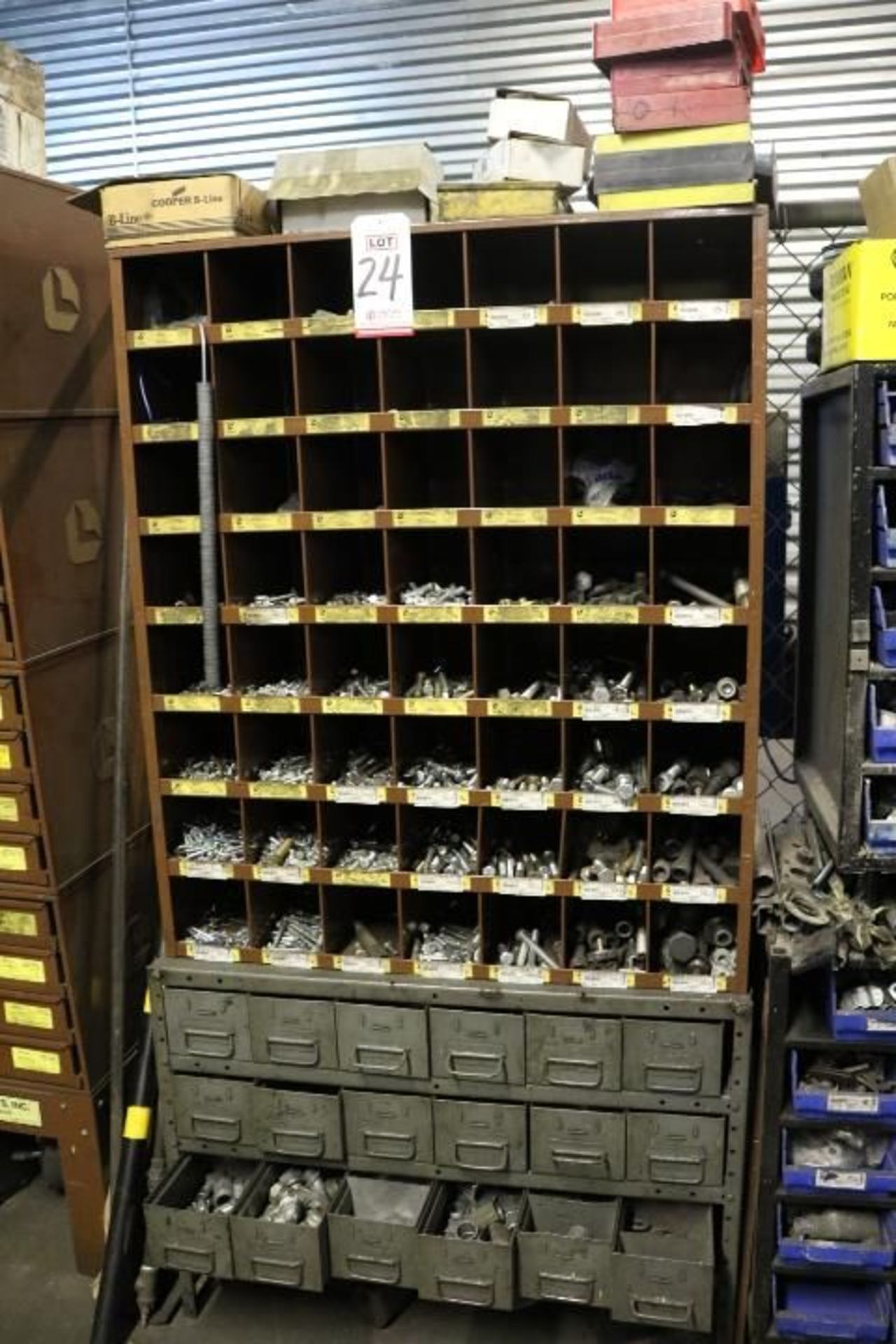 Lot 24 - HARDWARE CABINET W/ (18) PULLOUT DRAWERS OF CONDUIT FITTINGS AND (56) CUBBYHOLES OF NUTS, WASHERS