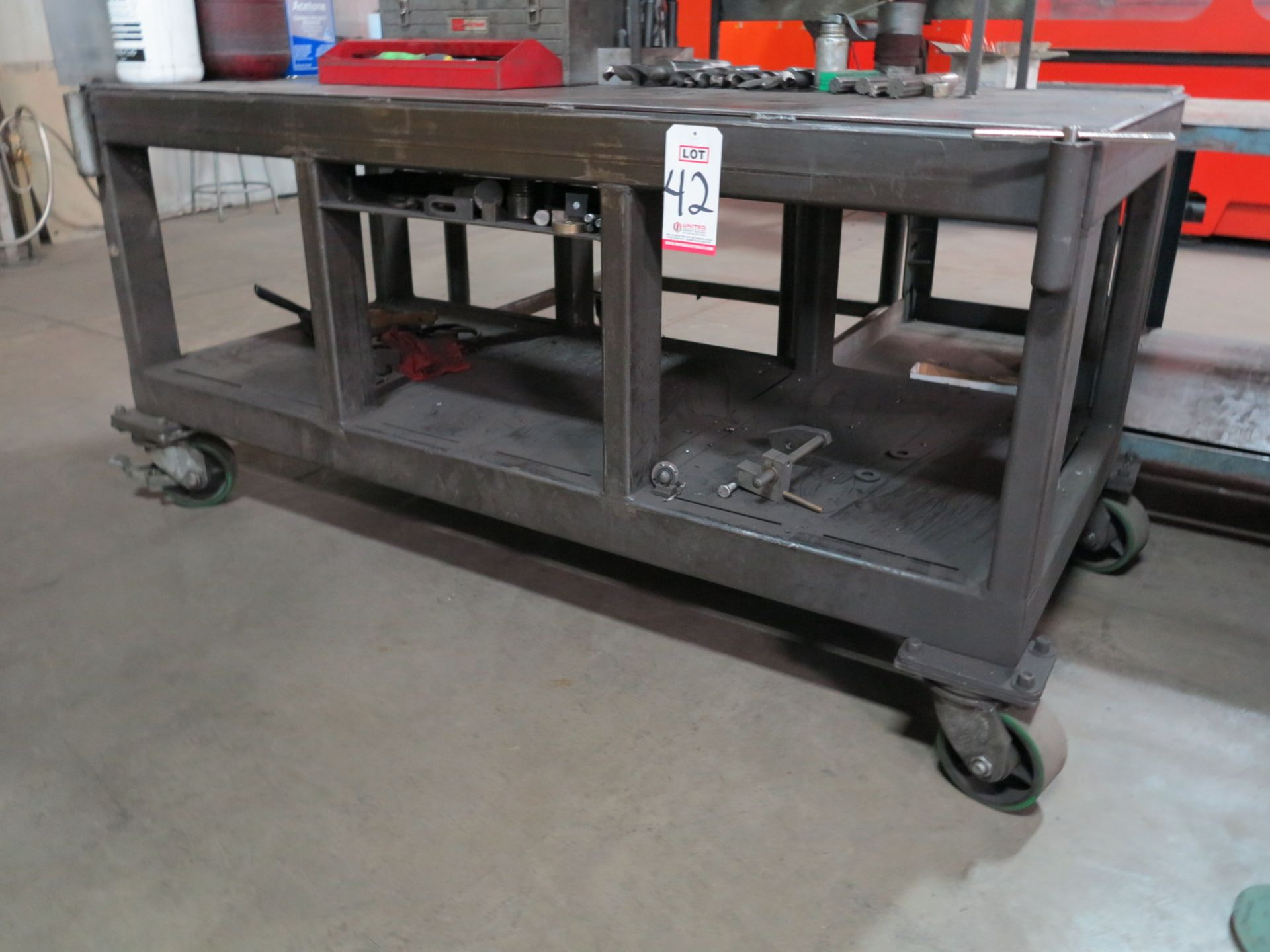 """Lot 42 - 6' X 32"""" HEAVY DUTY WORK BENCH ON CASTERS, CONTENTS NOT INCLUDED"""