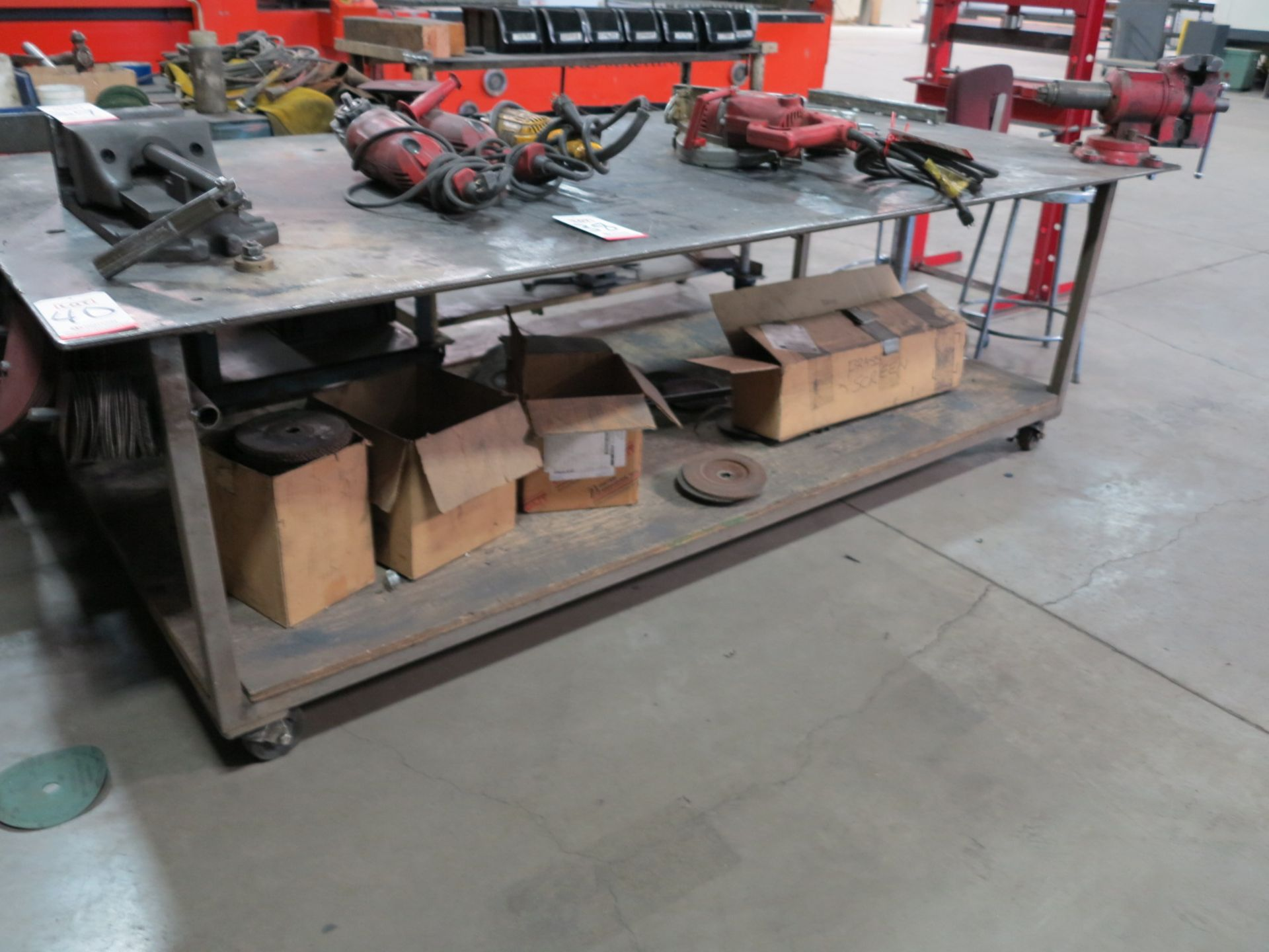 """Lot 40 - 8' X 4' STEEL TABLE ON CASTERS, W/ 5"""" VISE AND MISC ANGLE GRINDER WHEELS"""