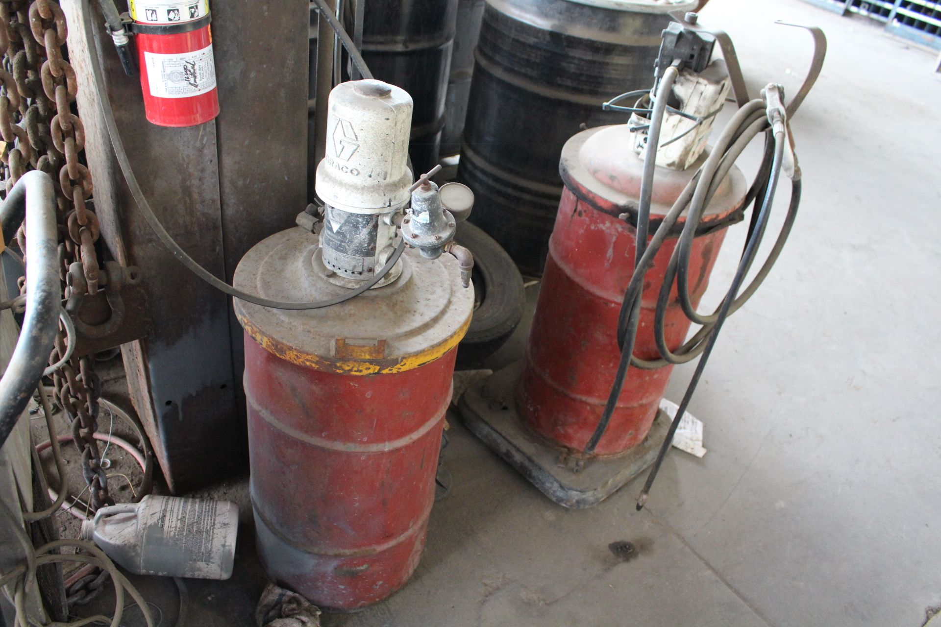 Lot 54 - LOT - (5) PCS TO INCLUDE (2) PNEUMATIC GREASE GUN PUMPS AND DRUMS, WOODS DEHUMIDIFIER, ELECTRIC