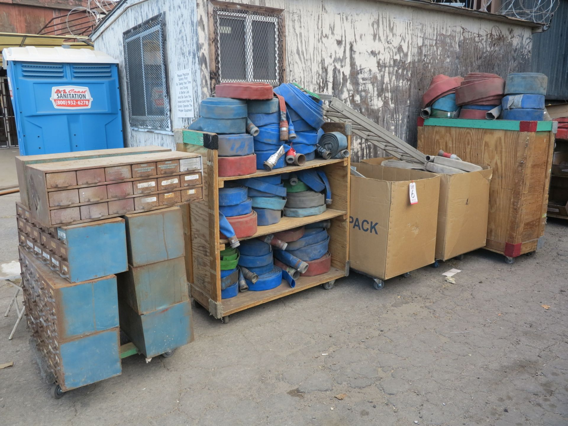 Lot 6 - LOT - (8) PARTS BIN CABINETS, (2) CARTS OF DISCHARGE HOSE, (1) BOX FIRE HOSE, (1) BOX OF EXTENSION