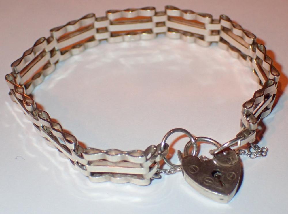 Lot 61 - Hallmarked silver three bar ten gate bra