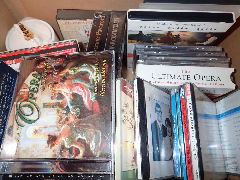 Lot 269 - Box of mixed CDs and a smoke alarm
