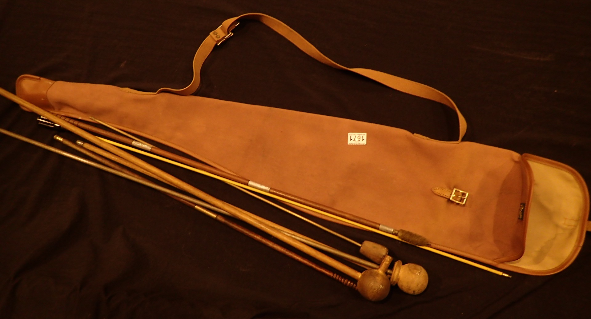 Lot 1671 - Canvas gunbag with mixed ram rods and as