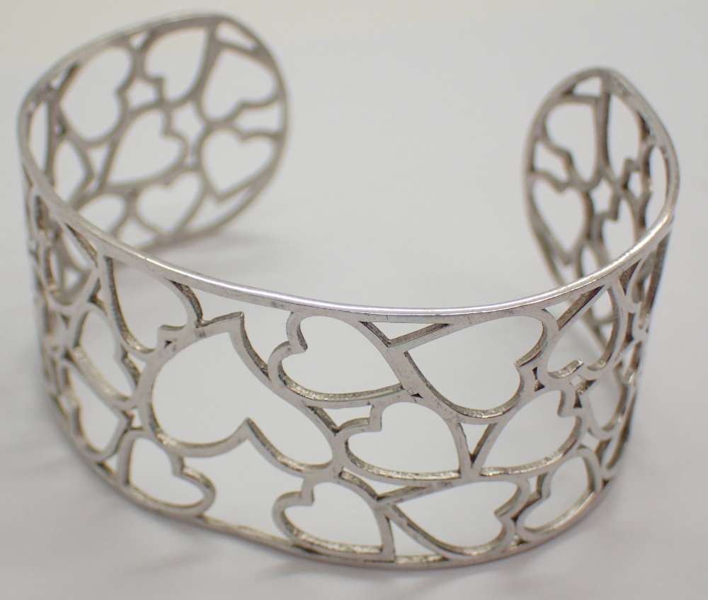 Lot 1204 - Sterling silver heart bangle fully hallm