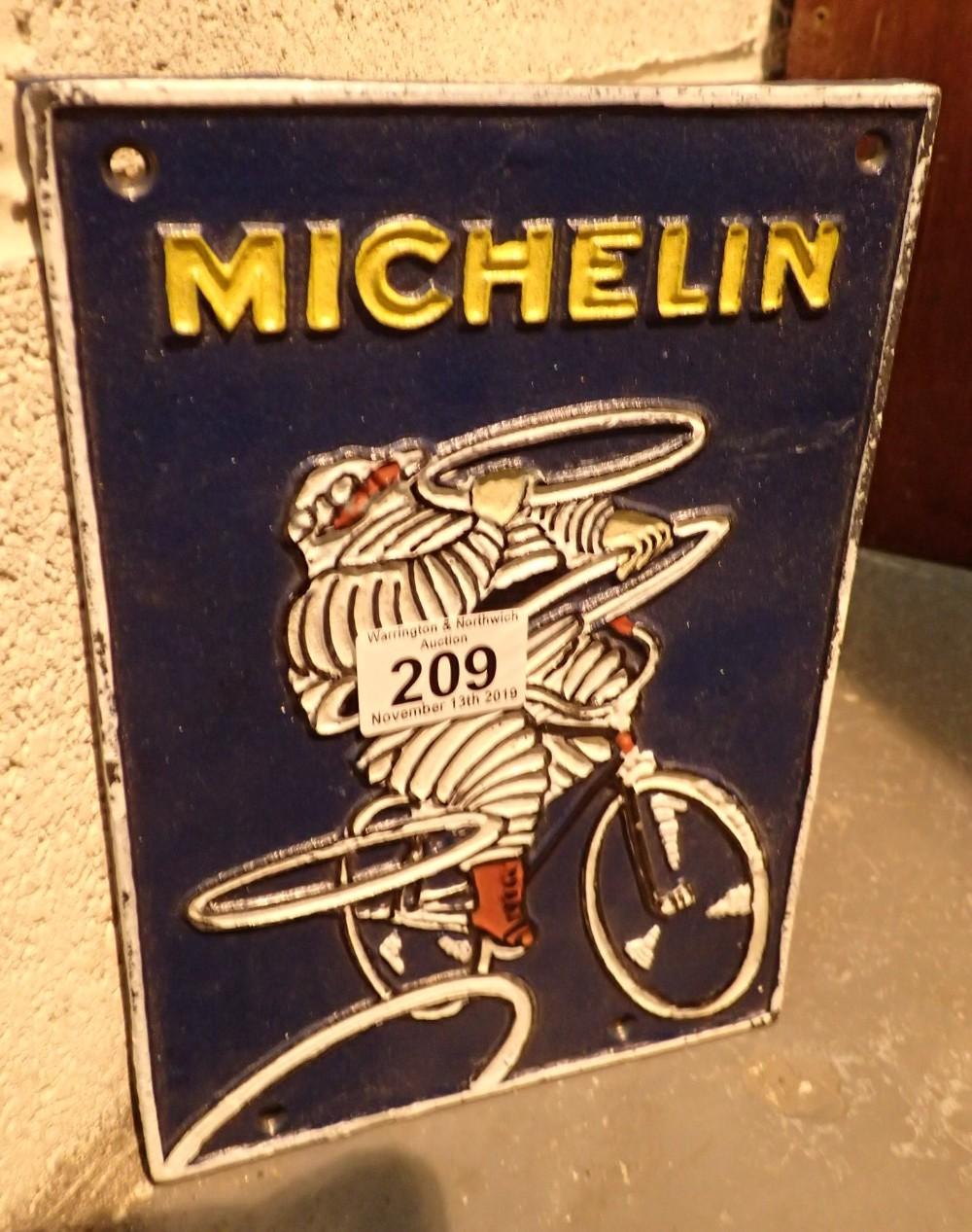 Lot 209 - Cast iron Michelin Man sign 25 x 18 cm