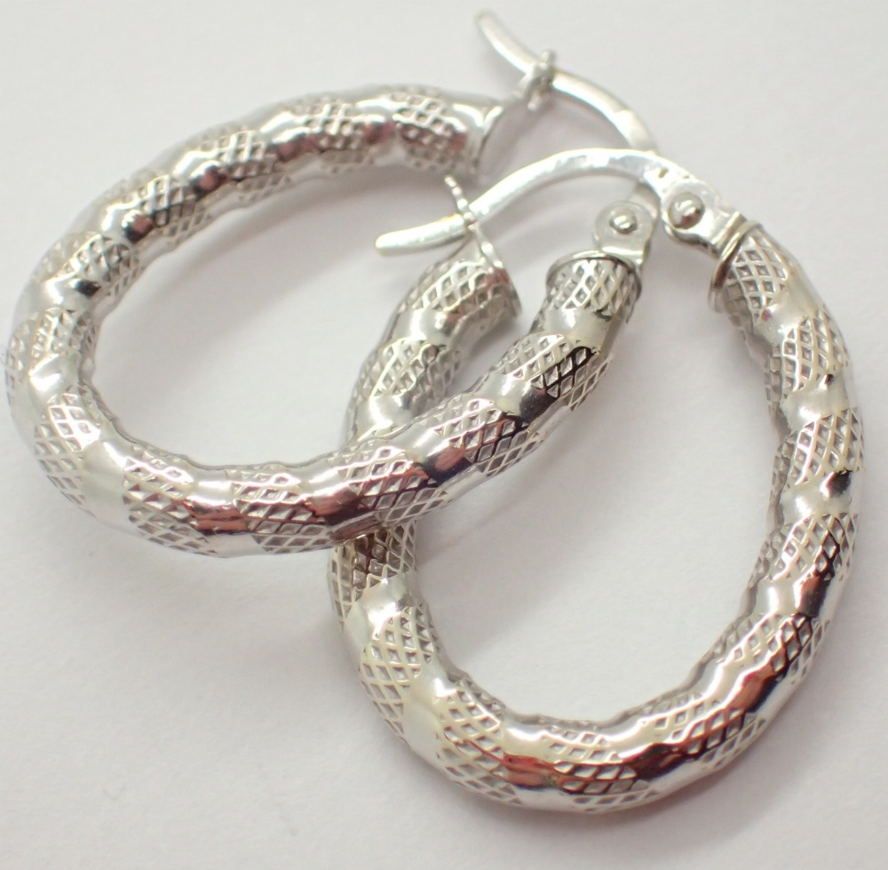 Lot 1238 - 9ct white gold hoop earrings CONDITION REPORT: Approximate size = 2 cm drop.