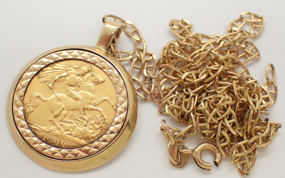 Lot 1211 - 1911 half sovereign loose mounted with 9ct gold chain total weight 12.