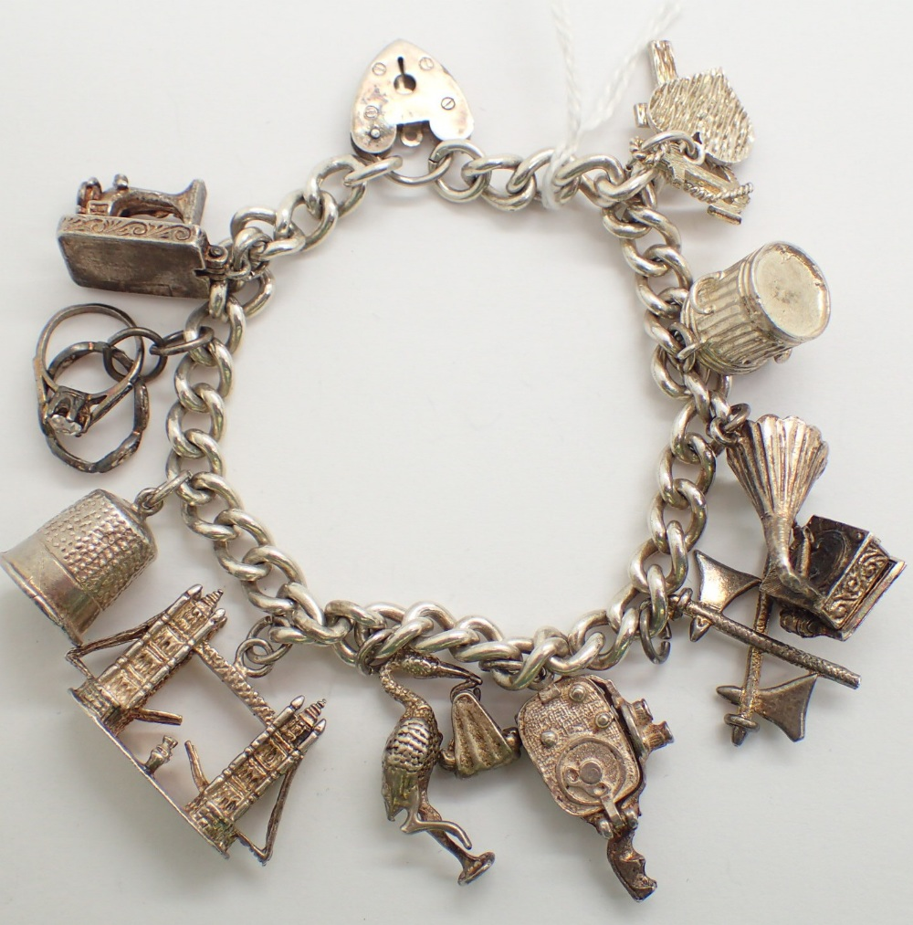 Lot 1217 - Hallmarked silver charm bracelet with ten charms some unmarked 53g
