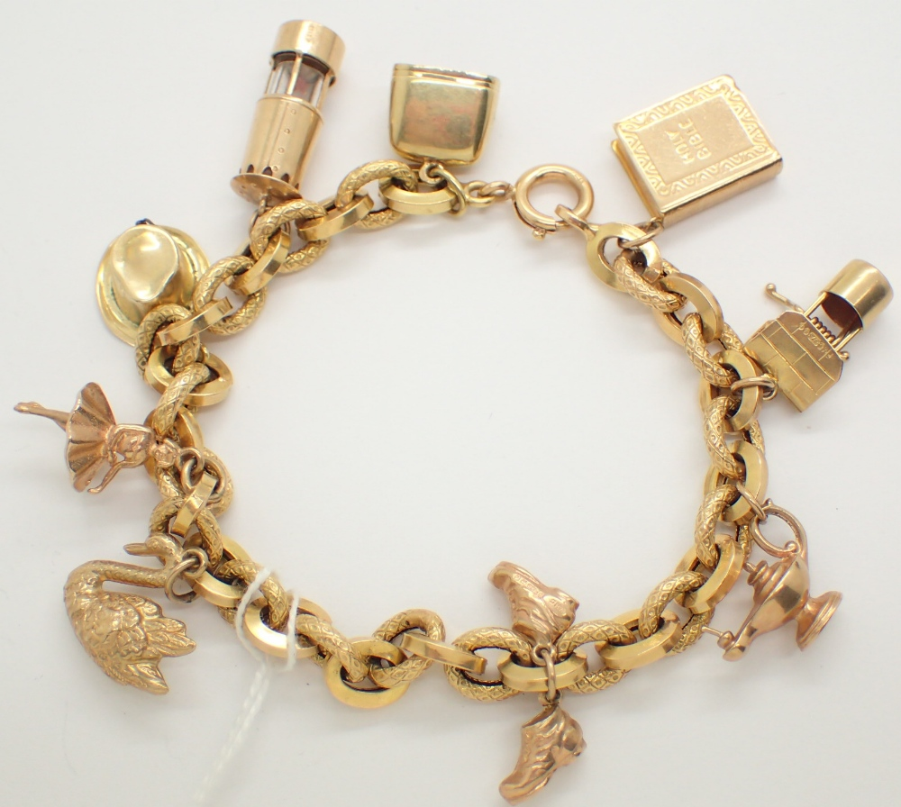 Lot 1213 - 9ct yellow gold charm bracelet with nine charms 22g