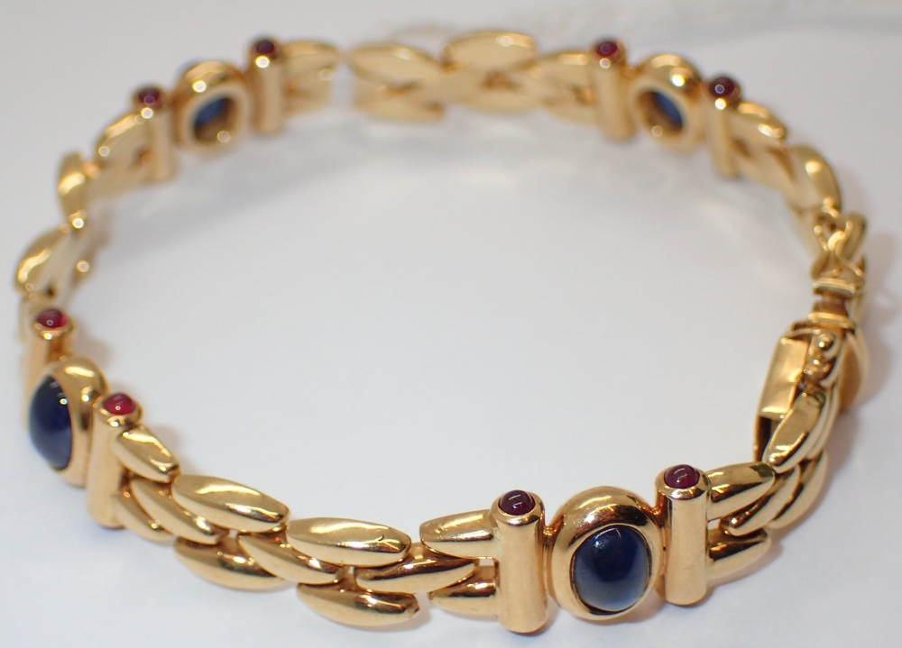 Lot 1258 - 14ct gold bracelet with rub over sapphires and diamonds 24.