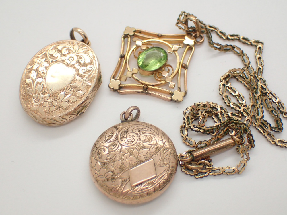Lot 1239 - Gold plated Edwardian green quartz set pendant on a rolled gold chain and two gold plated lockets