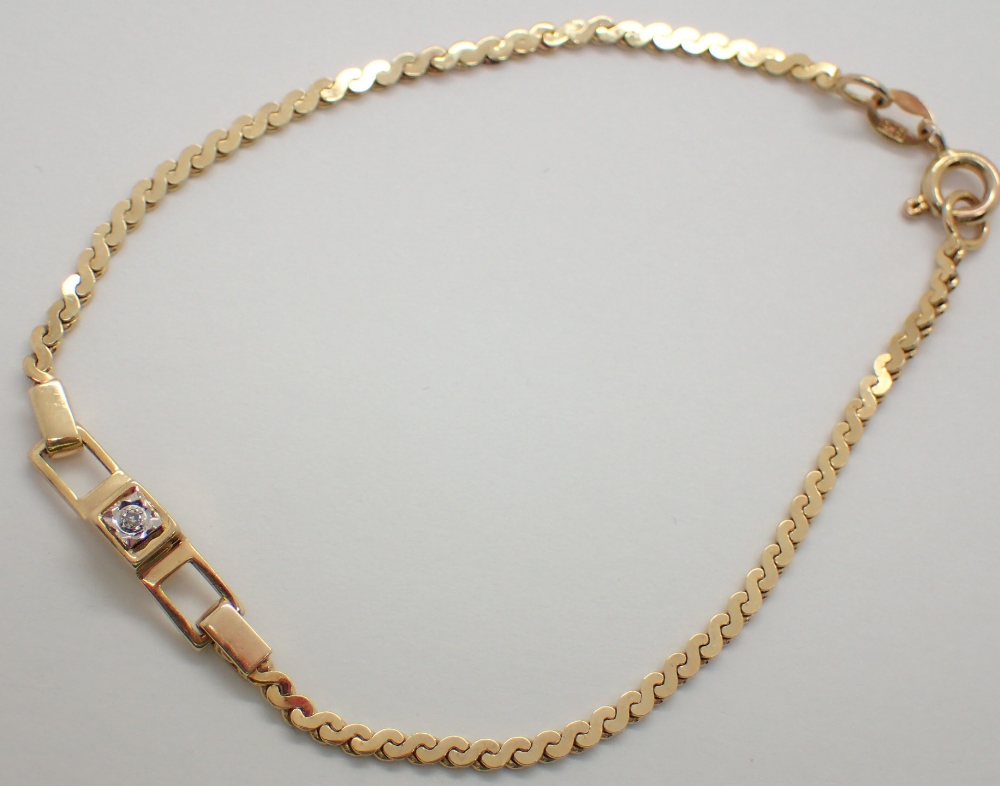 Lot 1203 - 9ct yellow gold bracelet set with a diamond 3.