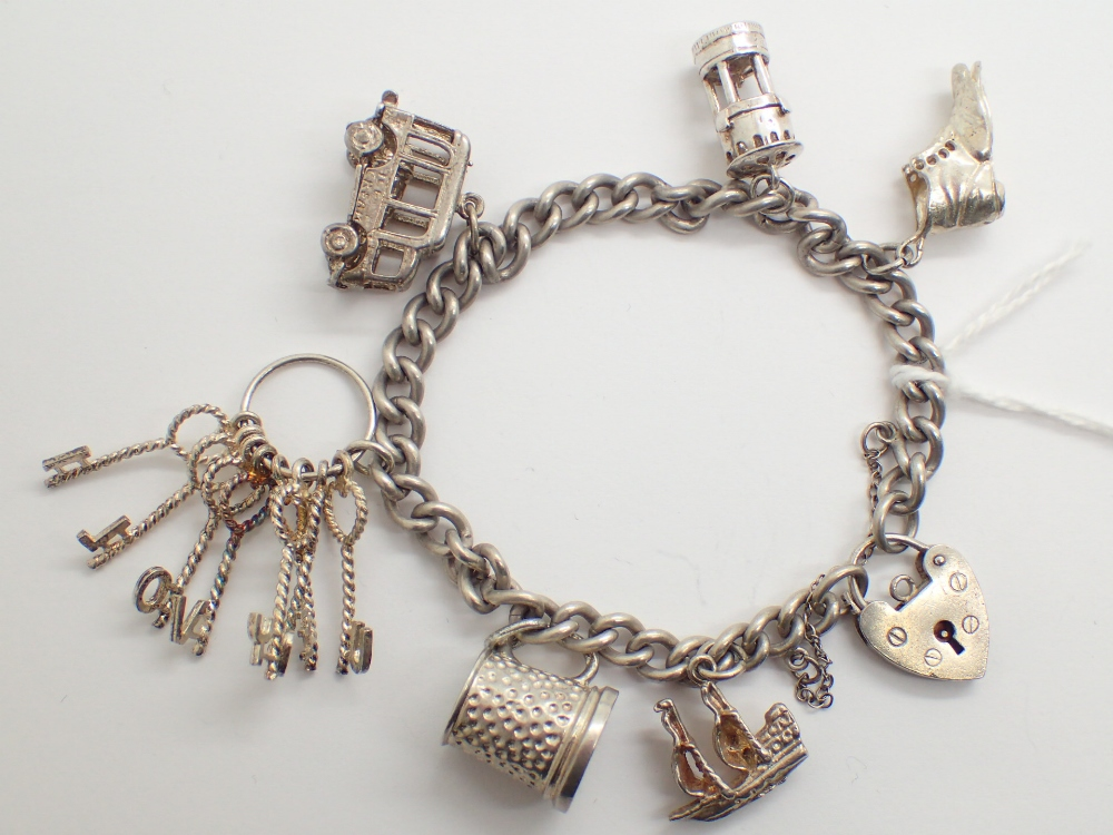 Lot 1205 - Sterling silver charm bracelet with six charms 39g