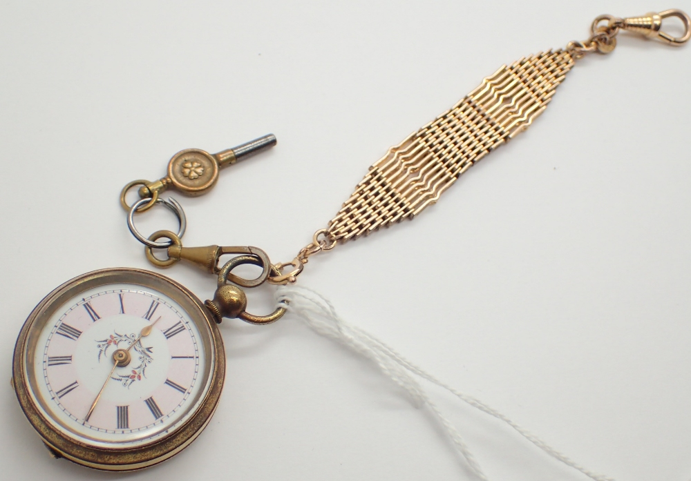 Lot 1256 - Yellow metal Victorian fob watch with key and chain CONDITION REPORT: This item was