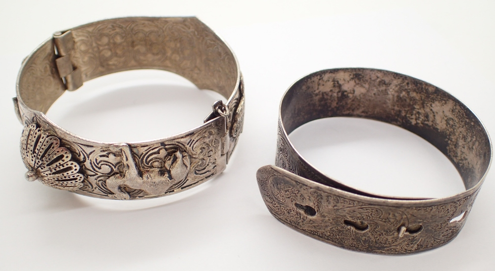 Lot 1207 - Hallmarked silver bangle and an Oriental white metal example