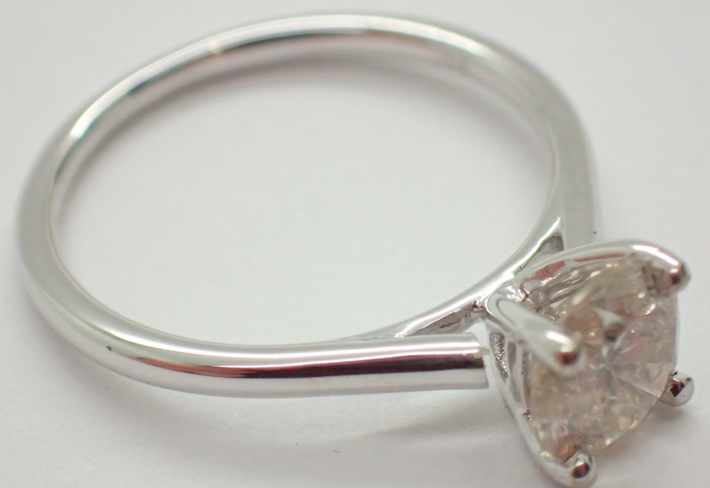 Lot 1246 - Bankrupt stock 18ct white gold diamond solitaire ring size M / N RRP £5000.00 1.