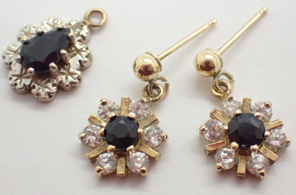 Lot 1234 - 9ct gold sapphire earring and pendant set