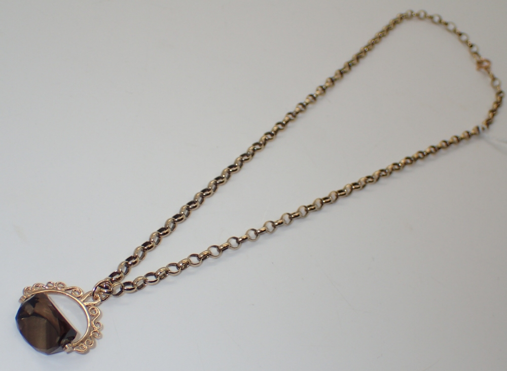Lot 1202 - 9ct yellow gold chain with smokey quartz gold mounted spinner fob 11.