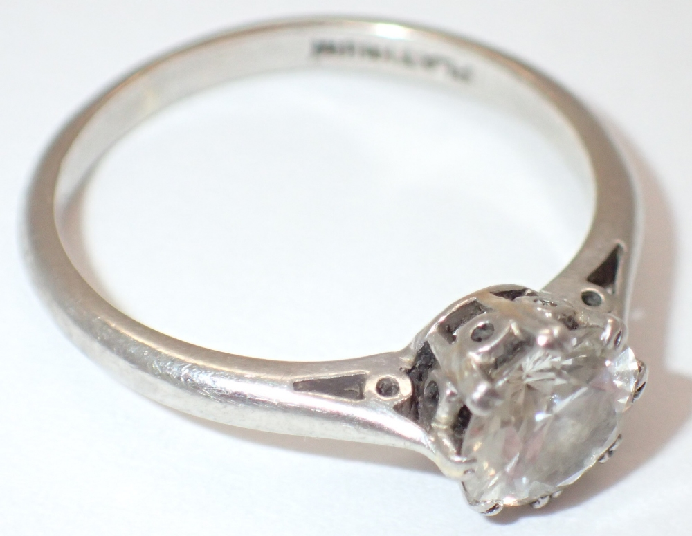 Lot 1223 - Platinum solitaire and diamond set ring approximately 0.75ct 2.