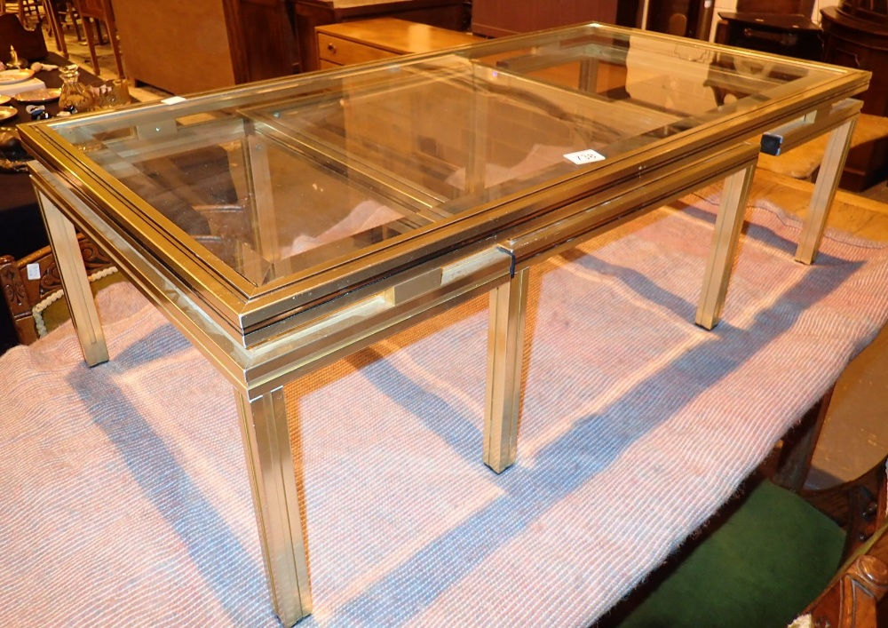 Lot 738 - Gilt and bevelled glass table with table undertier by Pierre Vandel of Paris 106 x 56 x 35 cm H