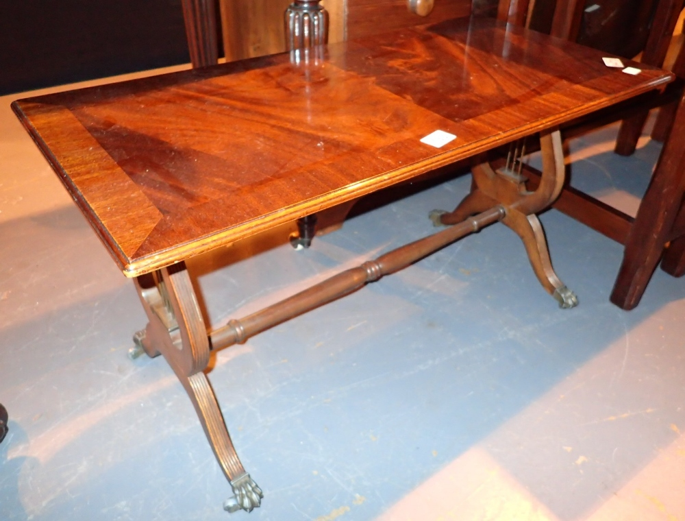 Lot 733 - Small coffee table with lyre supports and claw feet