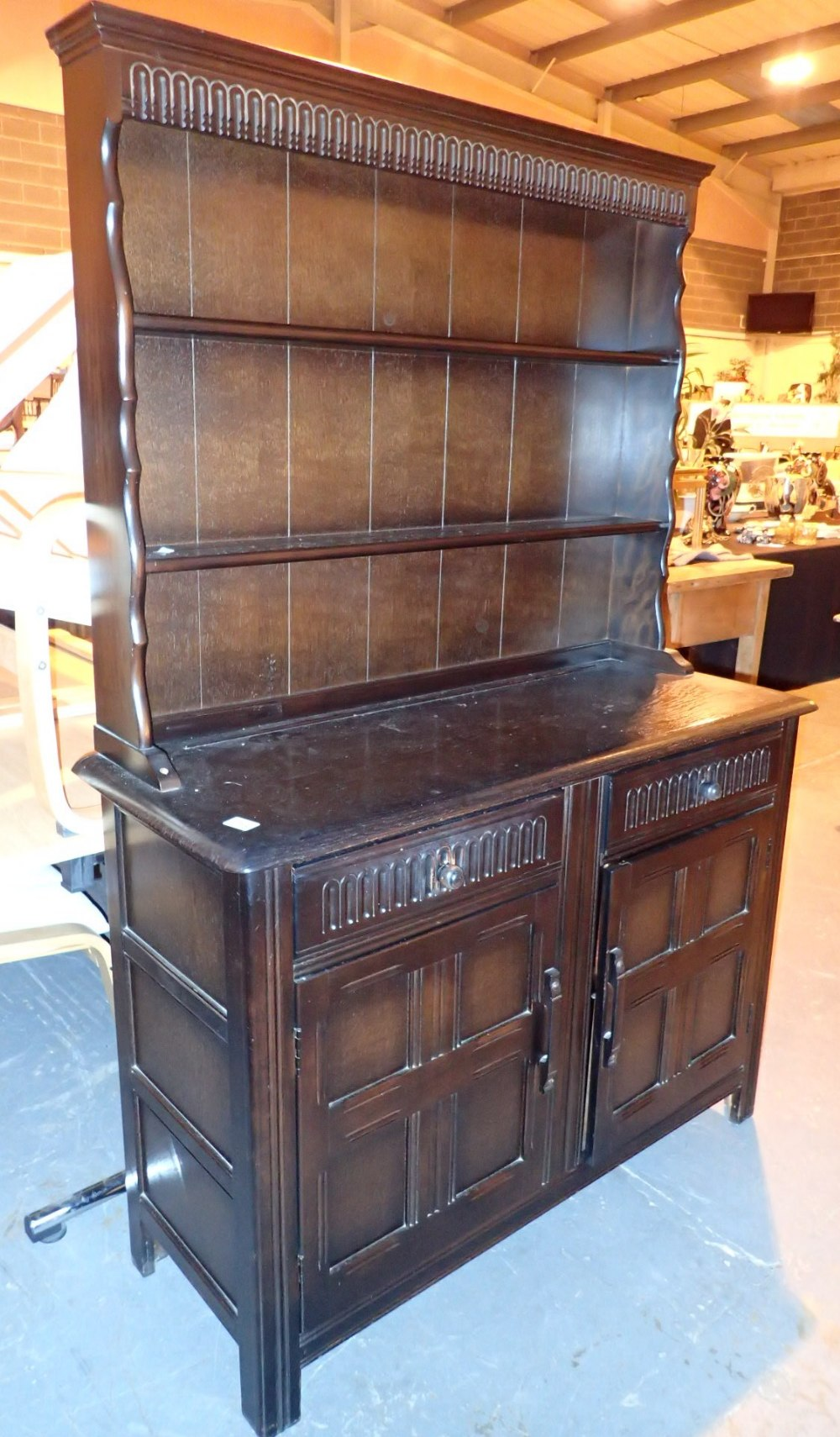 Lot 713 - Dark oak dresser with two cupboards and two drawers 122 x 46 x 177 cm H