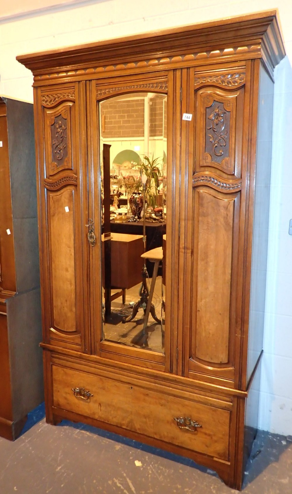 Lot 744 - Large carved walnut mirror door wardrobe 112 x 45 x 200 cm H