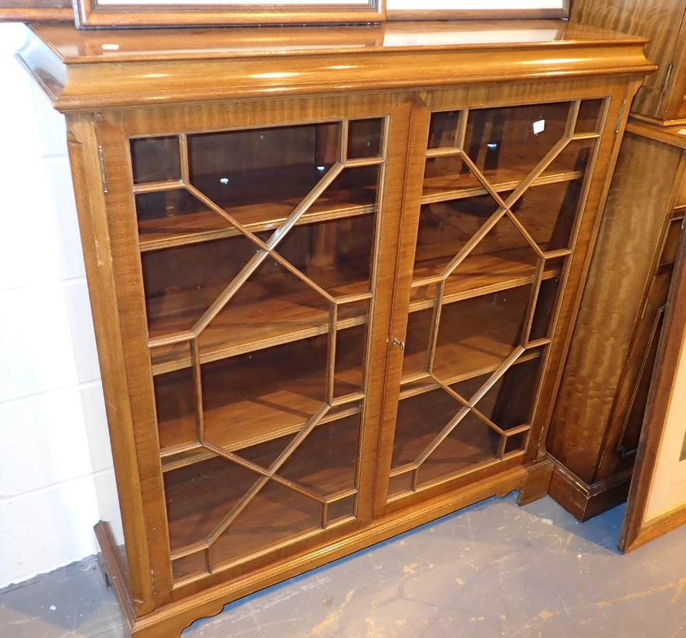 Lot 749 - Astragal glazed mahogany bookcase on bracket feet 108 x 32 x 112 cm H