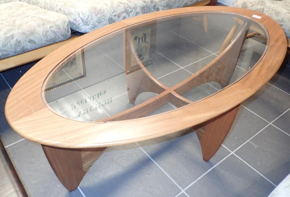 Lot 721 - G Plan oval glass top teak coffee table 67 x 120 cm