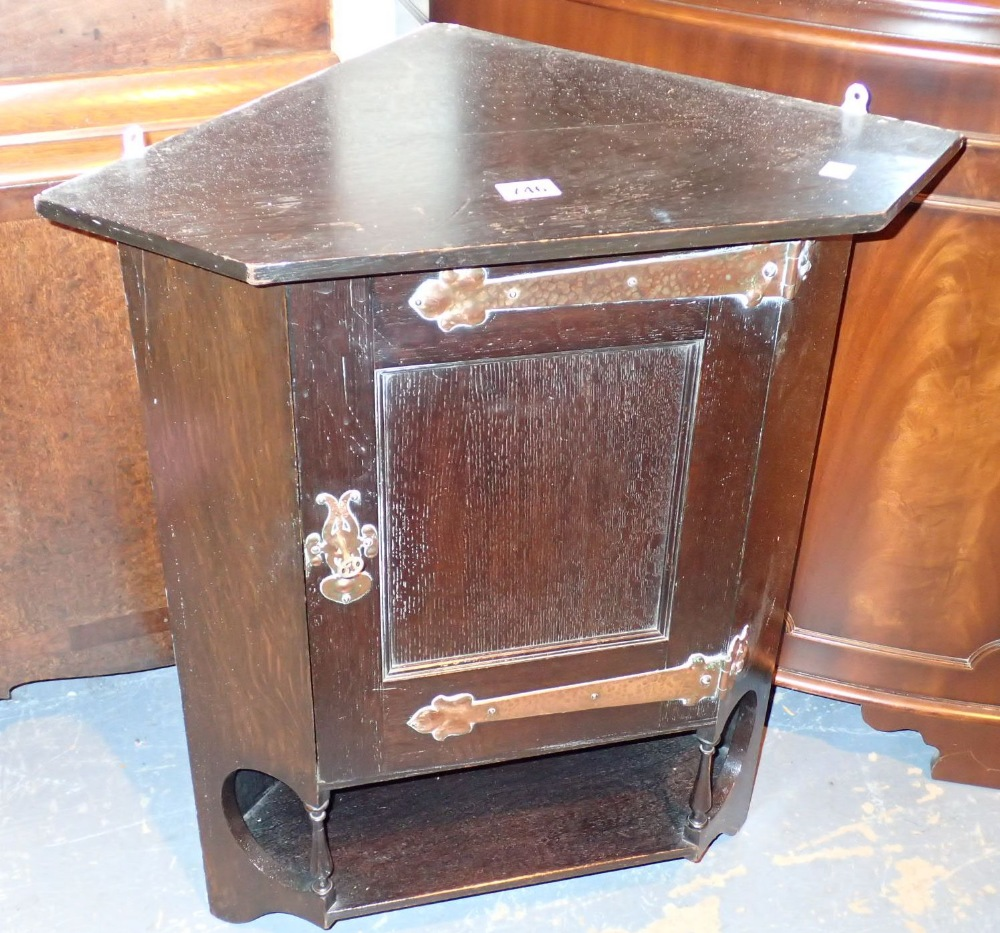 Lot 746 - Oak wall hanging corner cupboard with copper hinges and fittings