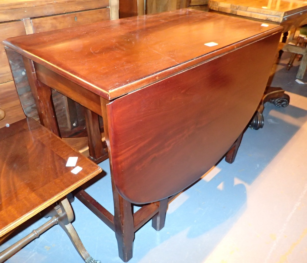Lot 734 - Mahogany gateleg dining table
