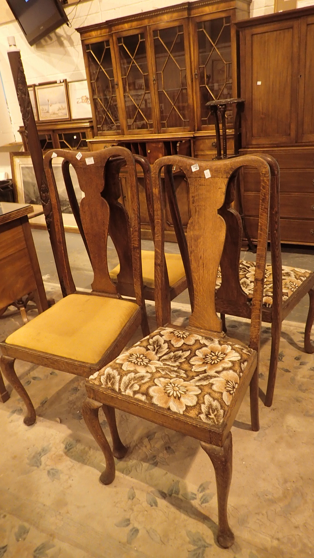 Lot 756A - Four Queen Anne style oak upholstered dining chairs with cabriole legs