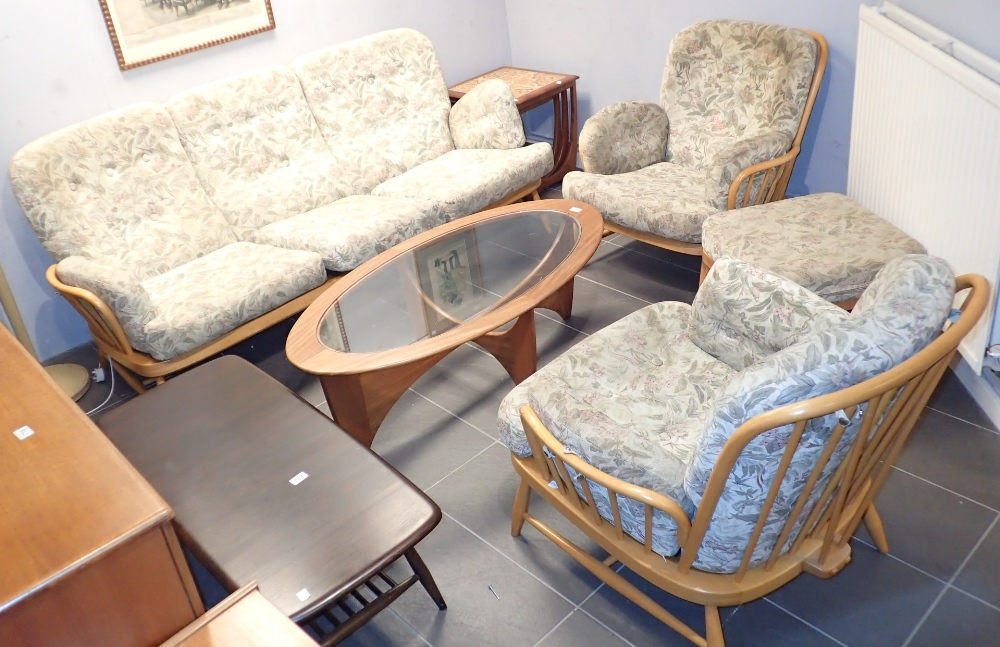 Lot 719 - Ercol light wood three piece suite and stool
