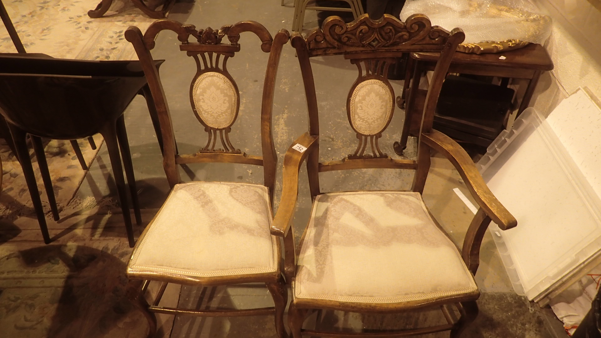 Lot 752 - Four Edwardian carved oak upholstered dining chairs including two carvers