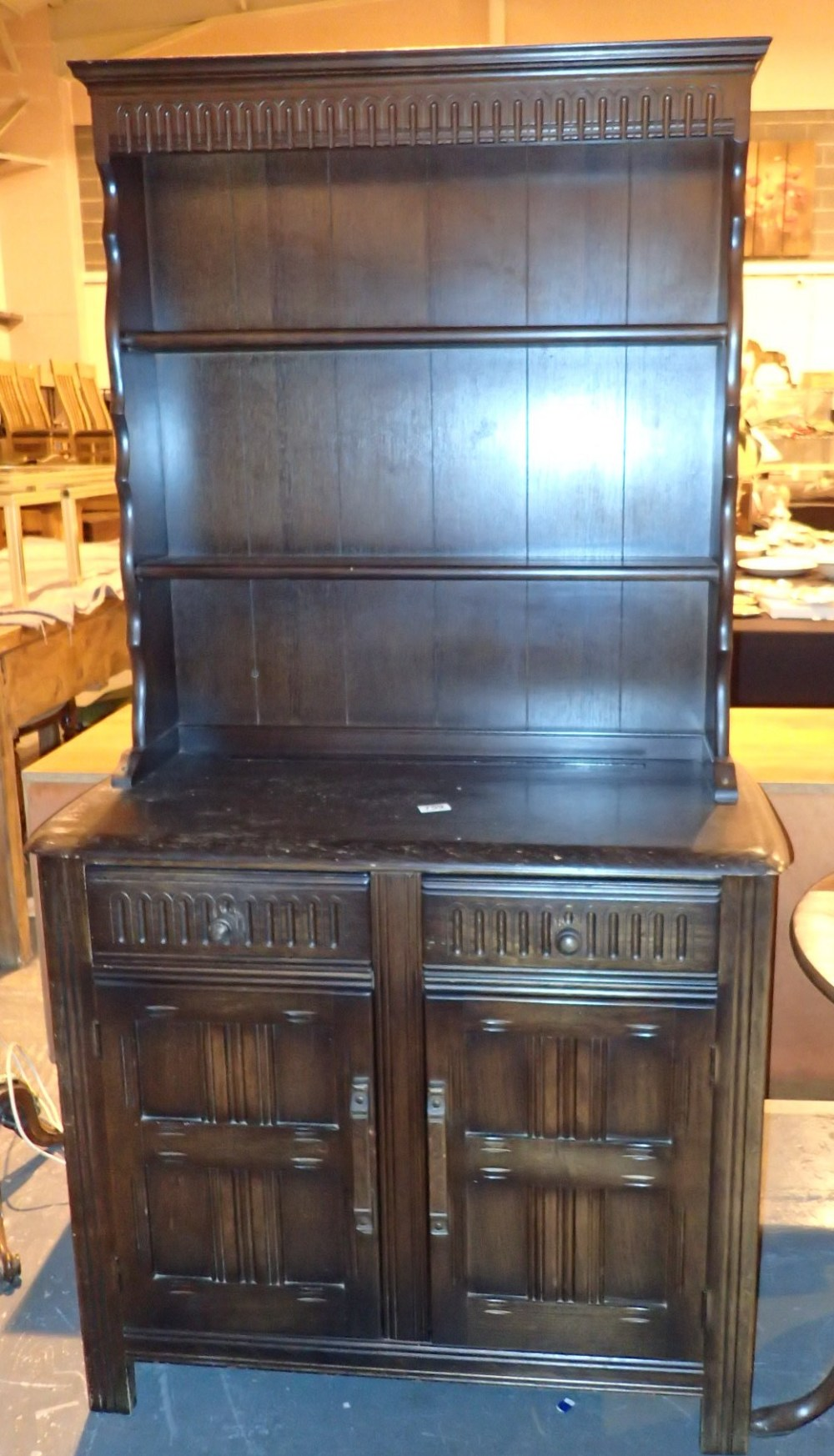 Lot 759 - Dark oak small dresser with two drawers over two cupboards