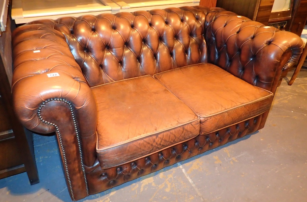 Lot 722 - Two seater leather button back Chesterfield