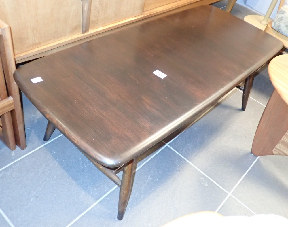 Lot 717 - Ercol dark coffee table with undertier