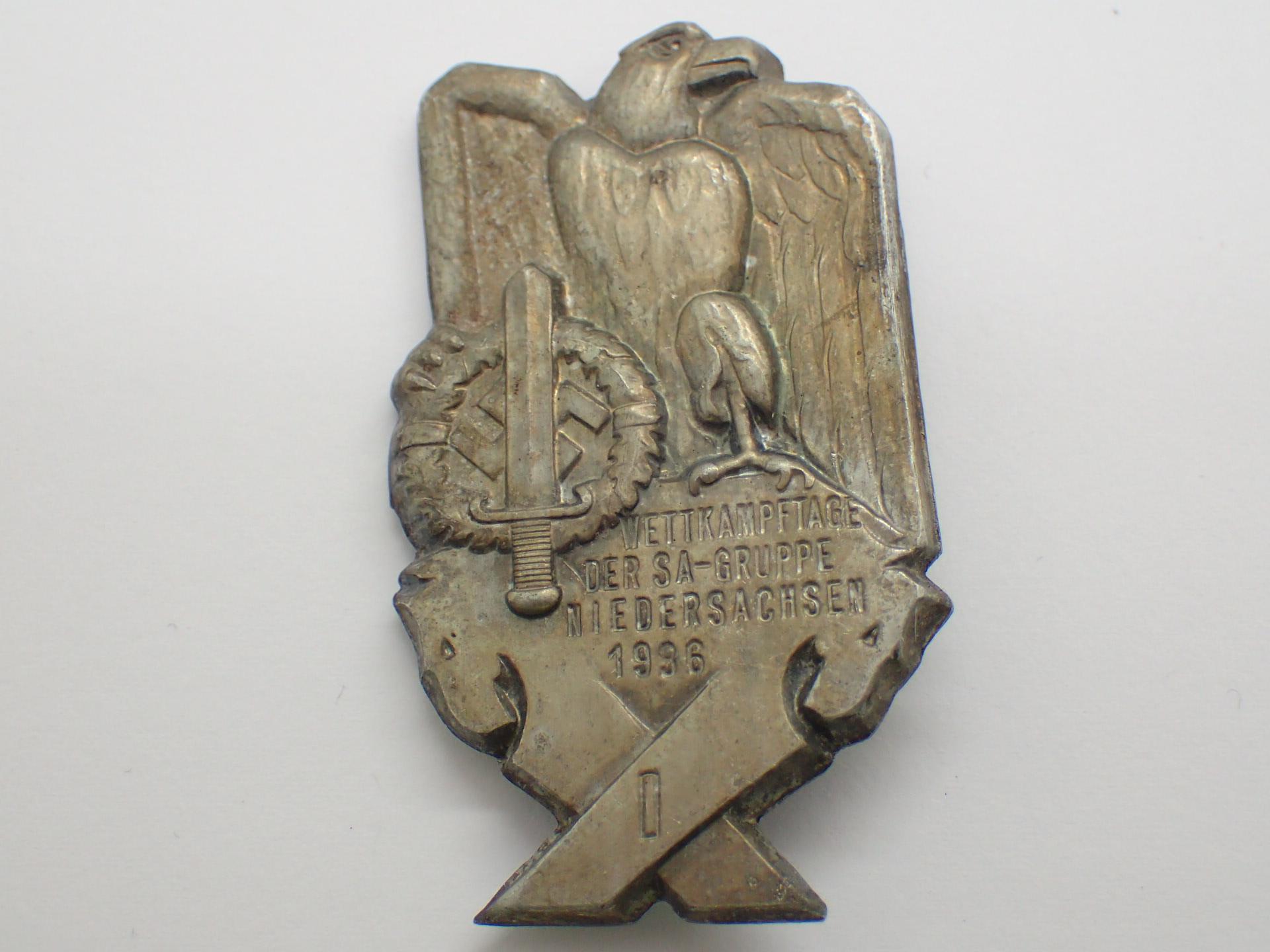 Lot 8 - WWII German pressed tin day badge