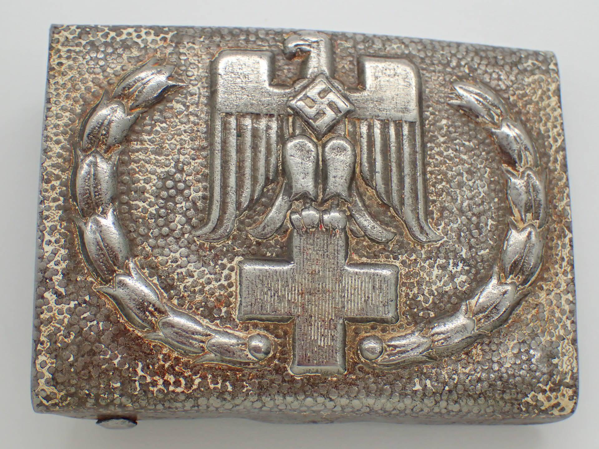Lot 43 - WWII German Red Cross pressed tin belt b