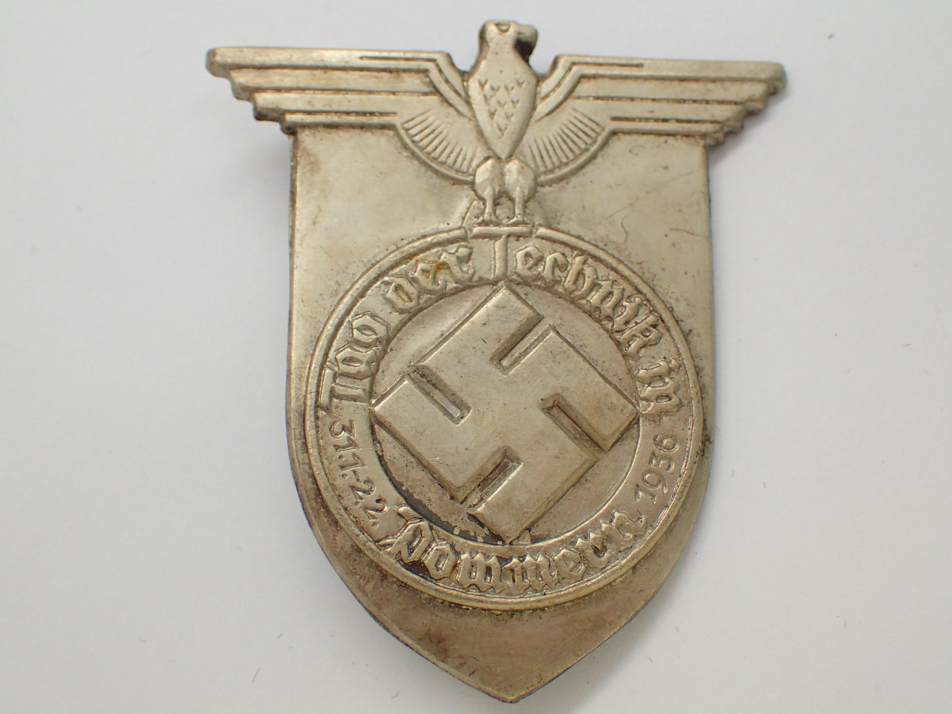 Lot 23 - WWII German pressed tin Swastika day bad