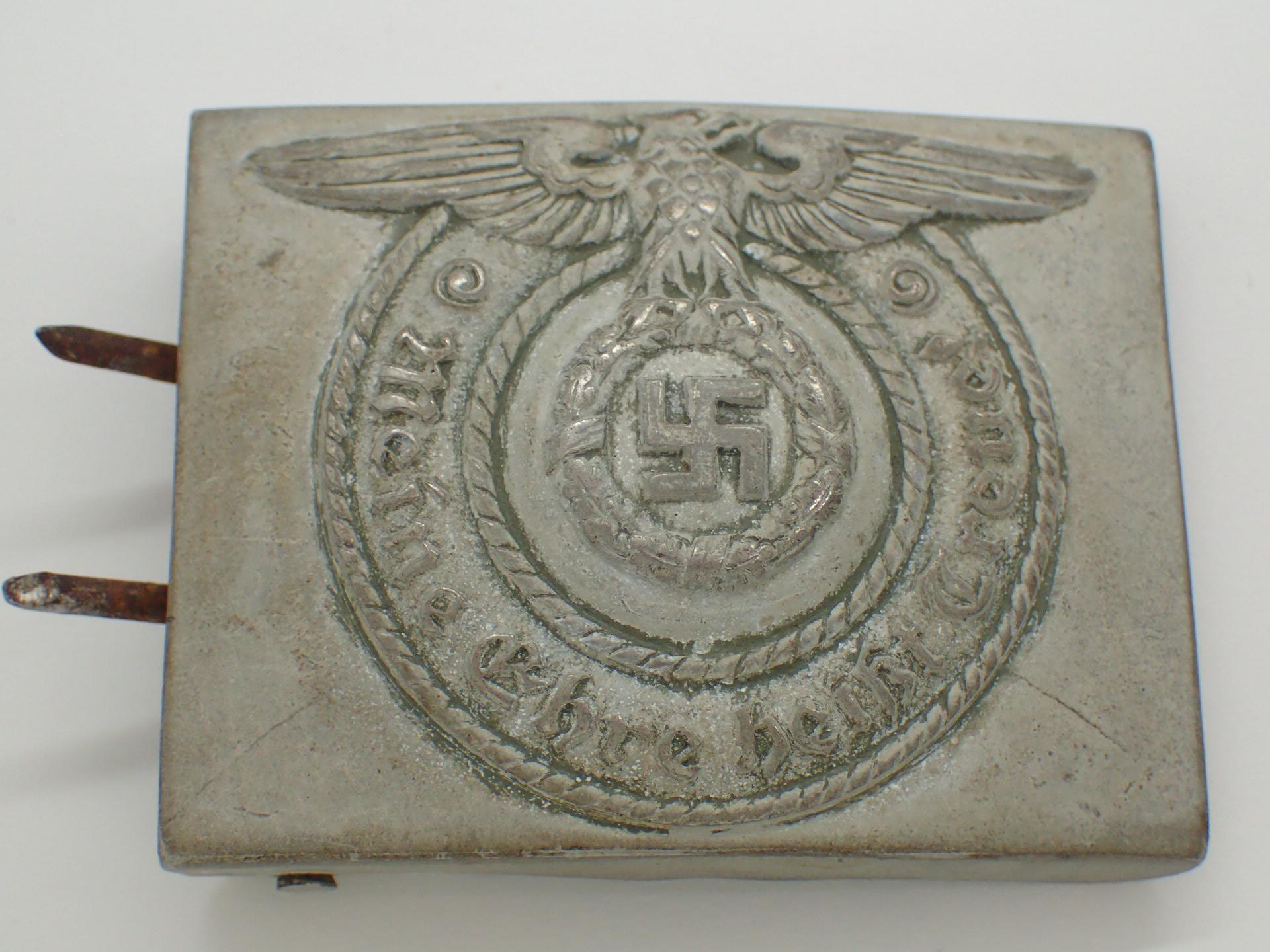 Lot 47 - WWII German SS pressed tin belt buckle