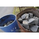 Lot 19 - TWO METAL OIL DRUMS CONTAINING BLACK COBBLE SETTS