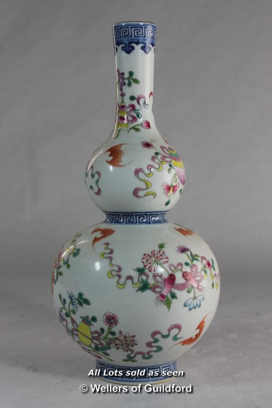 Lot 7249 - A Chinese double gourd vase painted with bats and flowers, 28.5cm.