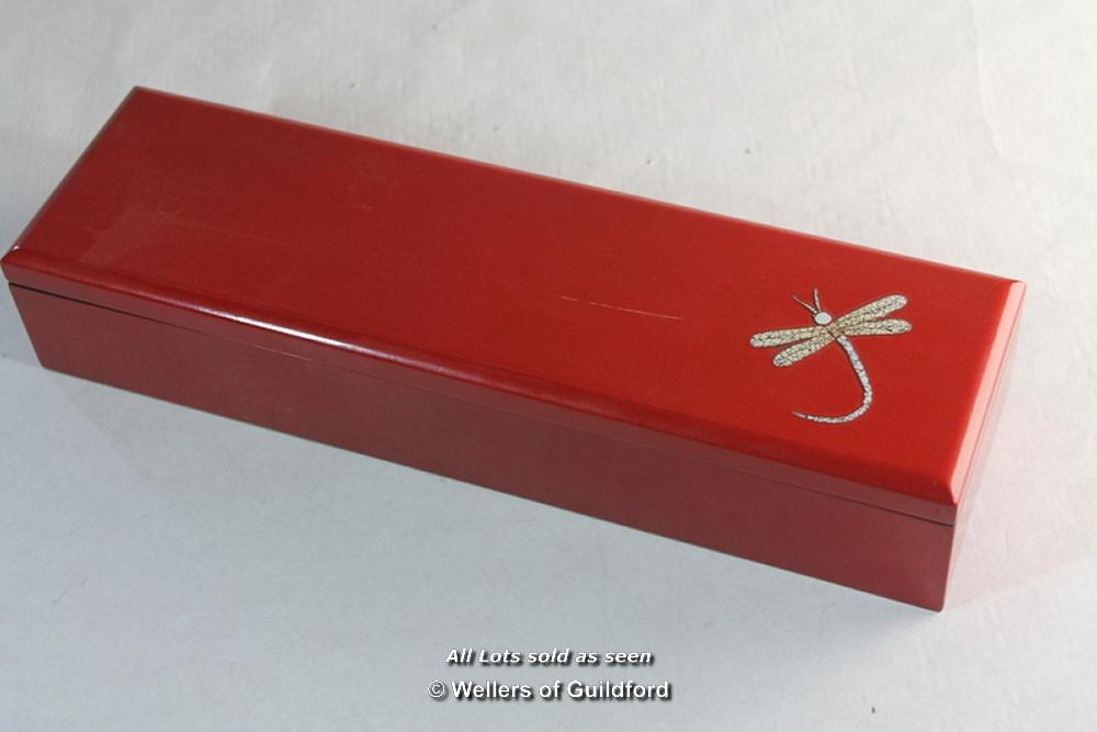 Lot 7204 - A South Korean lacquer box, hinged lid opening to reveal a lift out tray, with carrying handles,