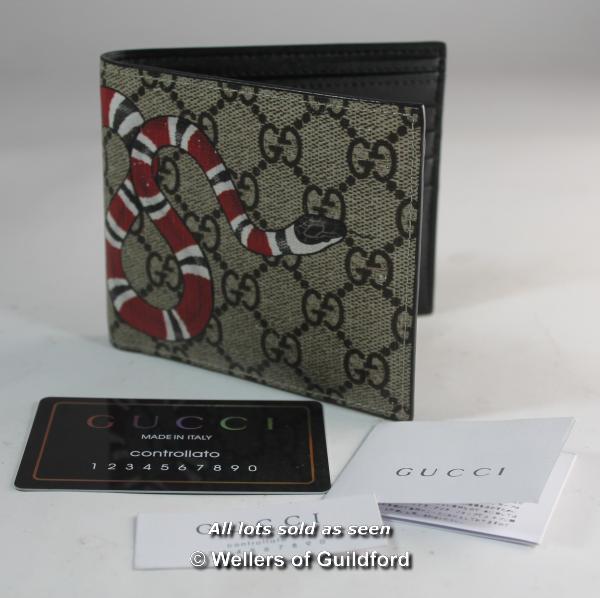 Lot 7358 - Gucci kingsnake print wallet.